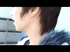 asian lad in car