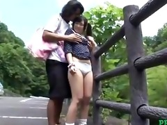 oriental girl drilled whilst bending to the fence
