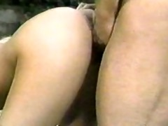 golden-haired oriental drilled from behind in park