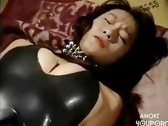 perverted asian receives her constricted latex