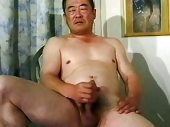 old oriental guy wanking his dick untill cumming