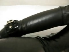 hotty in rubber with bag on head and sex toy
