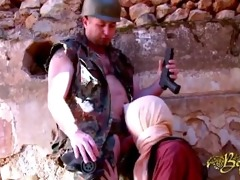 an arab woman gets a torment by a soldier