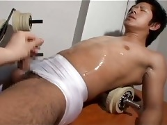 man wanking his oriental allies dick in gym