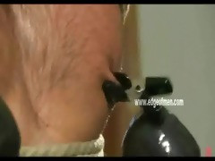 obedient homo chap has his nipples clamped while