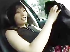 shy japanese woman shows meatballs in car.flv