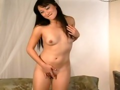 oriental playgirl plays with her cum-hole -