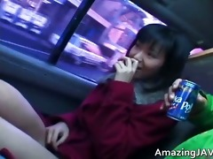 sexy oriental chick in car having enjoyment