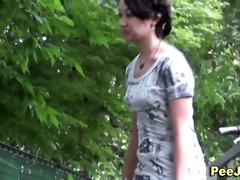 japanese chick piddles outdoors