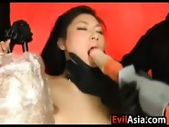 oriental slave pounded by a machine