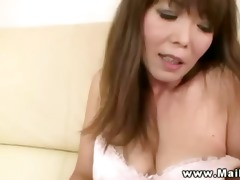 breasty oriental cougar getting undressed