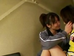 japanese cheerleader giving a kiss her lesbian