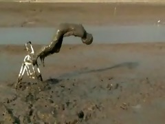 gal diving headfirst into unfathomable mud