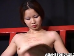 oriental gal moans whilst being whipped