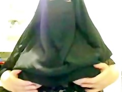 arabian muslim ummah lady in dark burqa shows