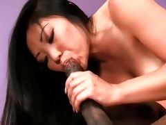 asian honey sits on a darksome dick and rides it