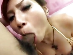 oriental cutie on her knees getting her throat